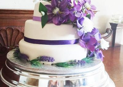 Gorgeous-White-With-Purple-Flowers-Wedding-Cake